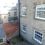 Durham - cleaning a very high window on a listed building
