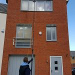 stockton on tees - cleaning a high window