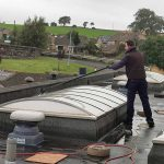 commercial window cleaning -a fragile roof light